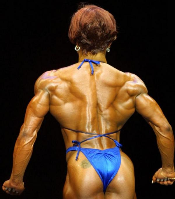 Christa Bauch posing on the bodybuilding stage