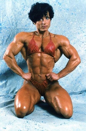 Christa Bauch posing in a bikini looking ripped