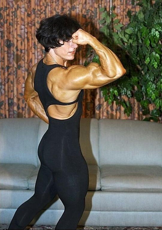 Christa Bauch flexing her biceps, looking awesome