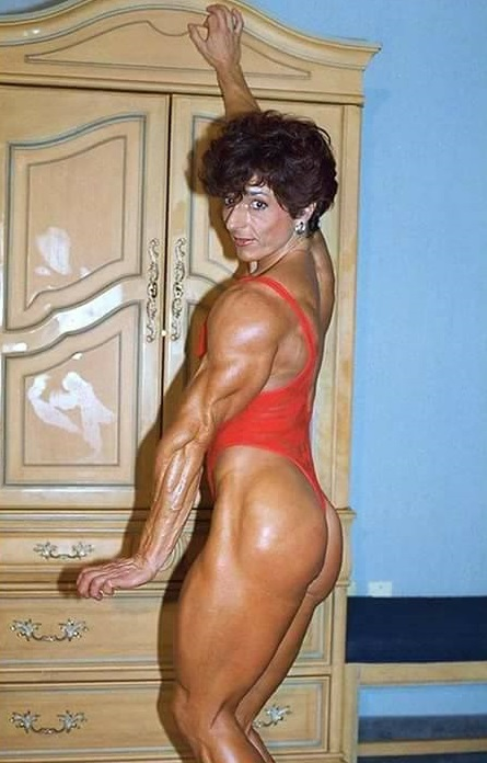 Christa Bauch flexing her ripped triceps