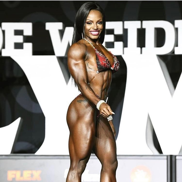 Cydney Gillon walking down the Joe Weider's Ms. Olympia stage and smiling at the audience