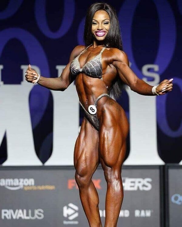 Cydney Gillon flexing on Joe Weider's Mr. Olympia stage