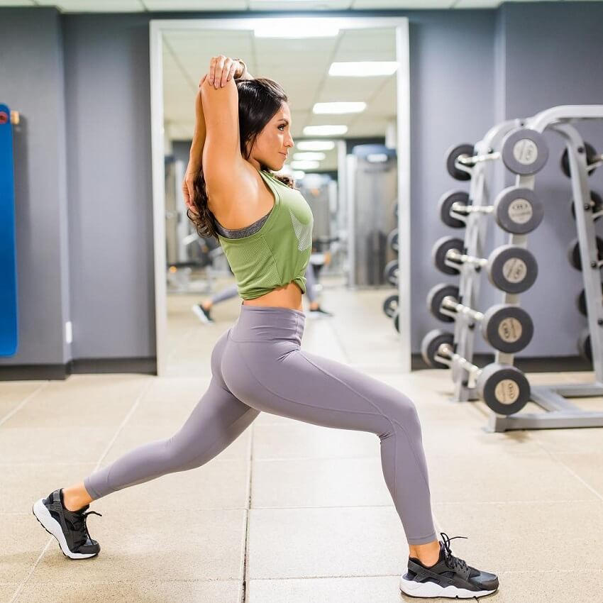Felicia Romero stretching in the gym