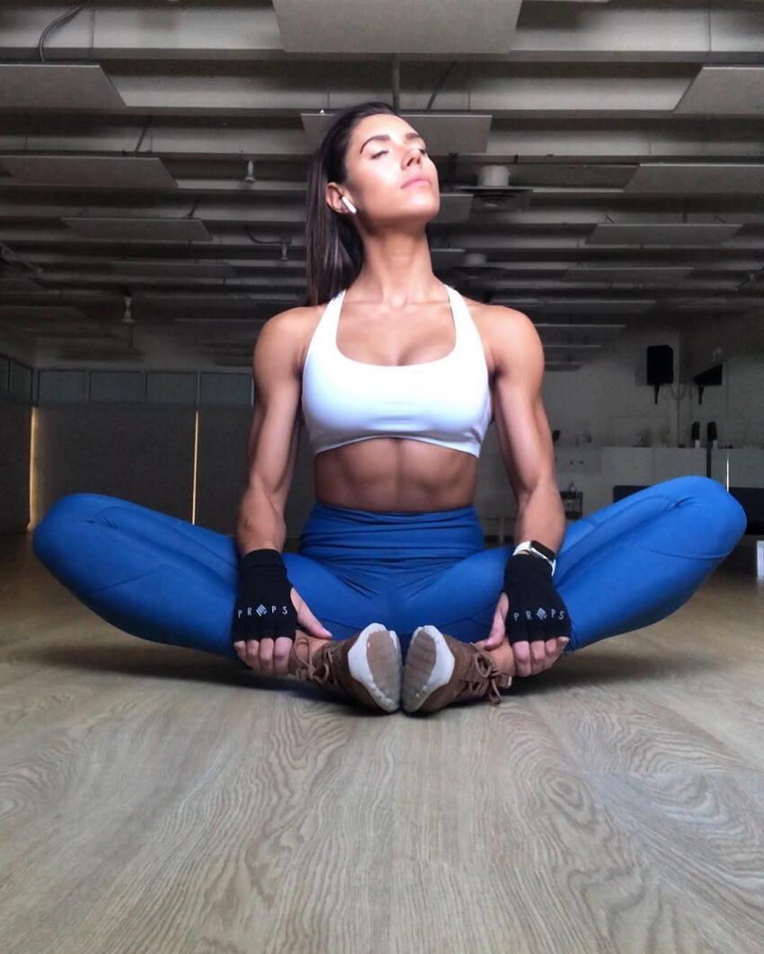 Kelsey Wells doing yoga