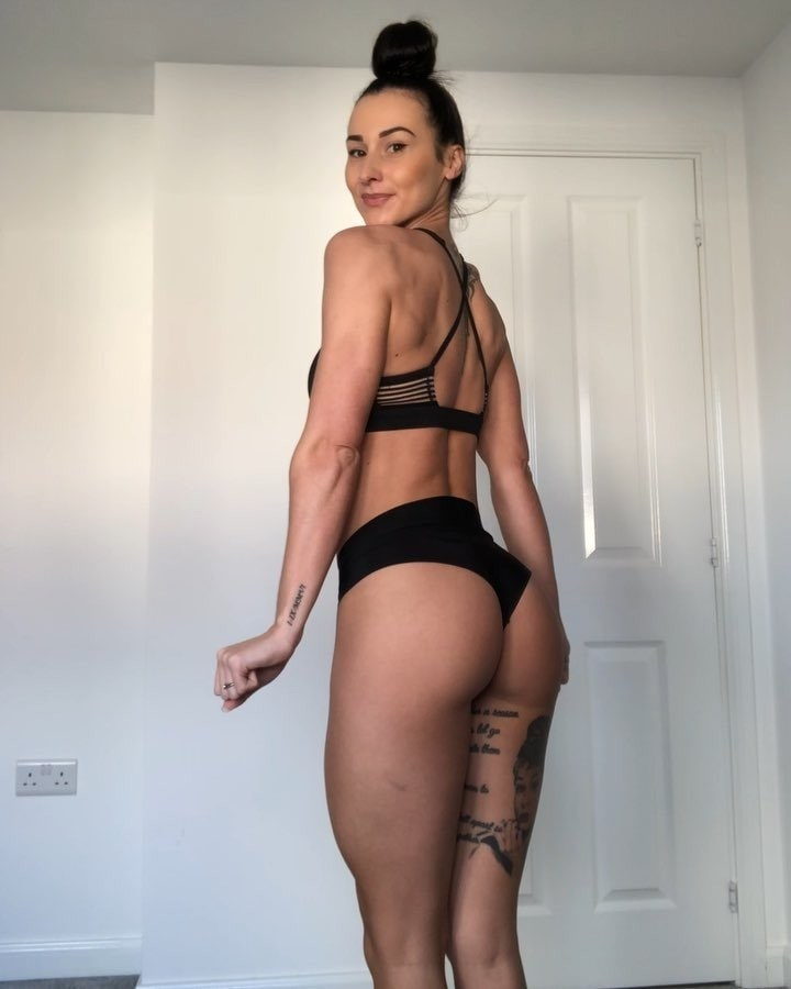 Lisa Lanceford posing in her house showing off her curvy legs and glutes