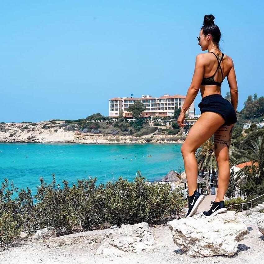 Lisa Lanceford standing on a hill near a beach