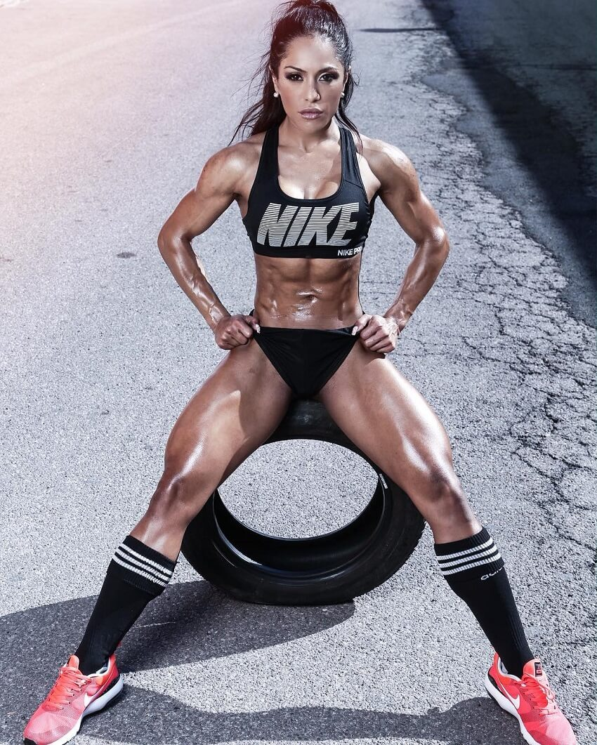 Maria Paulette sitting on a tire in sports clothes