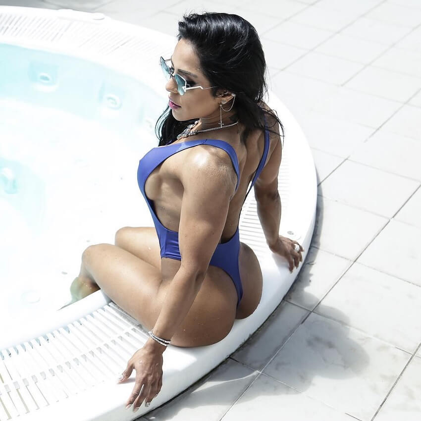 Maria Paulette sitting by a pool looking fit and lean