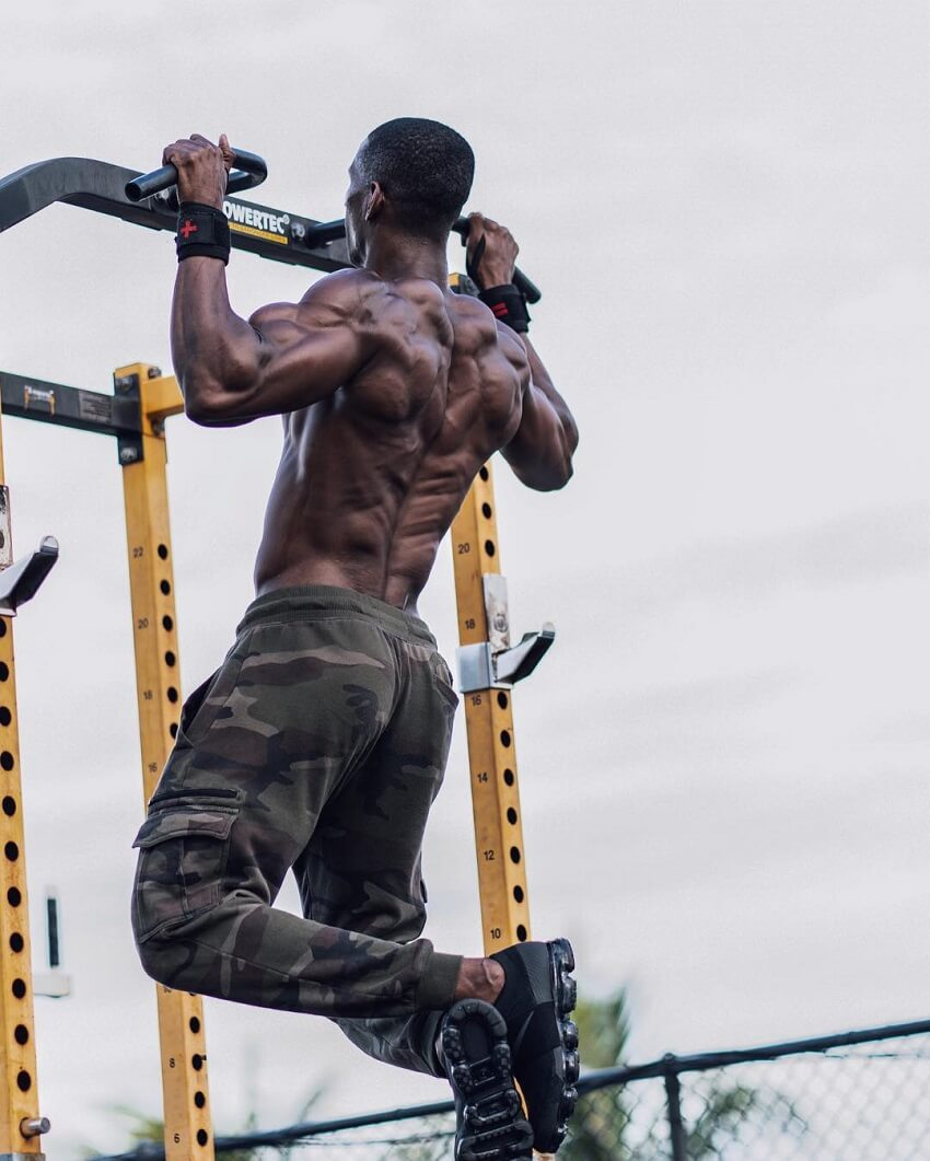 Max Philisaire doing pull ups outdoors