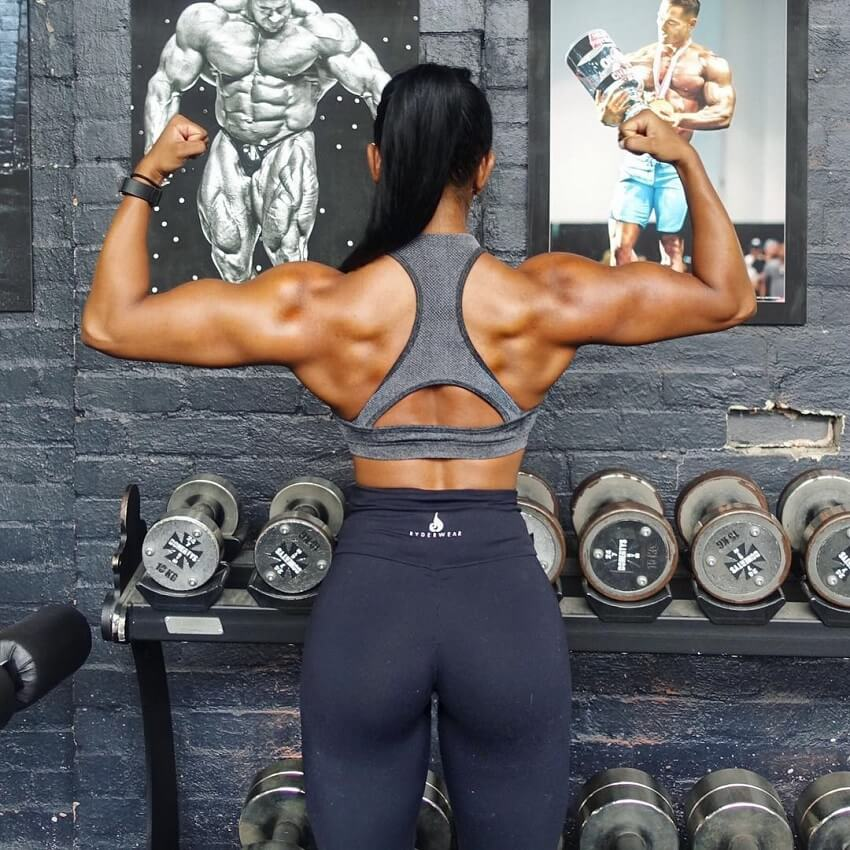 Melissa Carver flexing back double biceps
