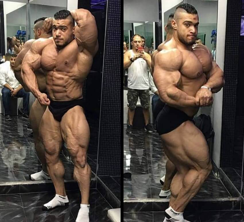 Mohammed Foda posing shirtless for the camera looking ripped and huge
