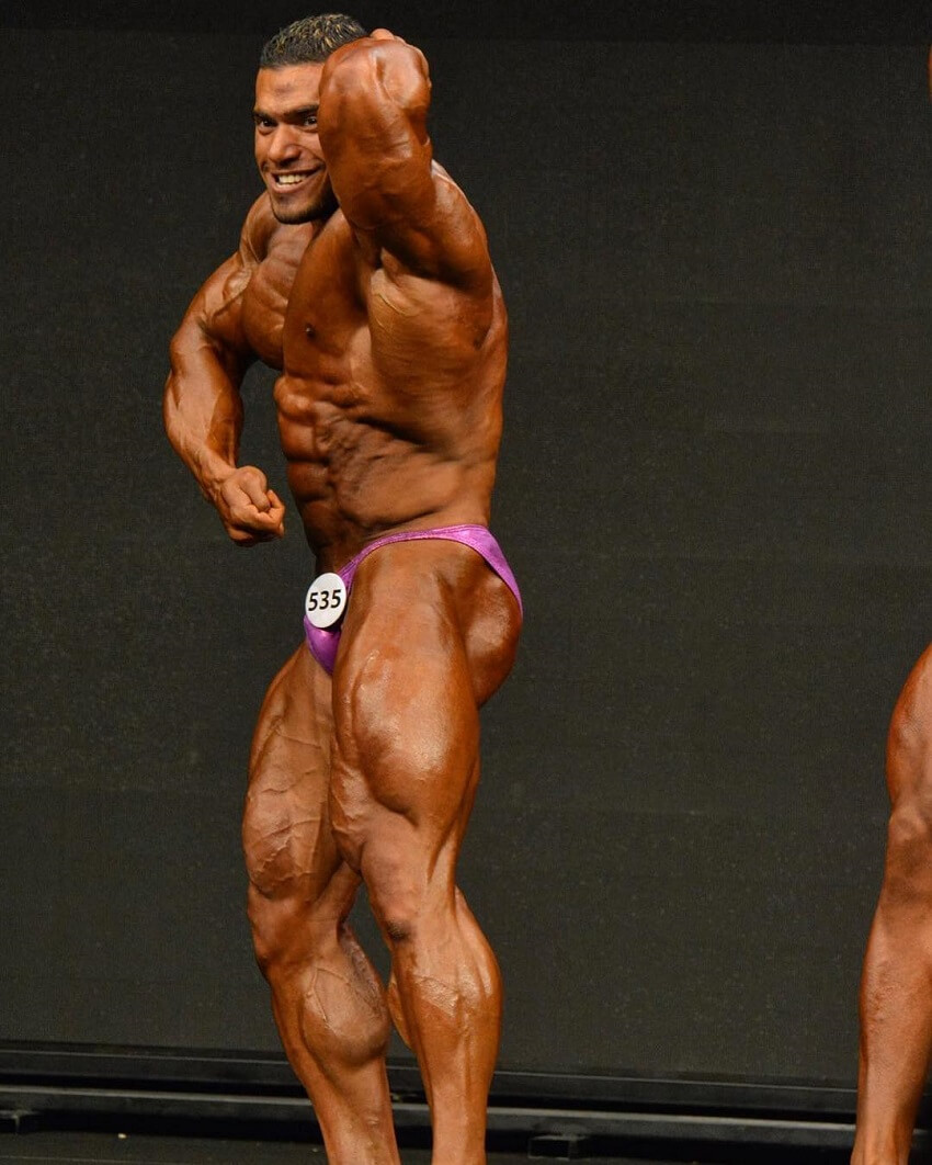 Mohammed Foda flexing his huge and ripped muscles in a bodybuilding contest