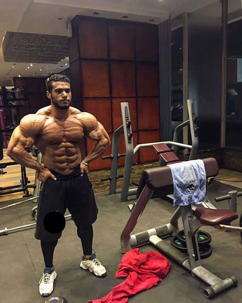 Mohammed Foda flexing shirtless in the gym