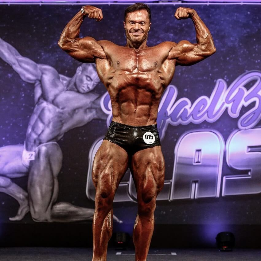 Renato Cariani hitting the front double biceps pose in a bodybuilding competition