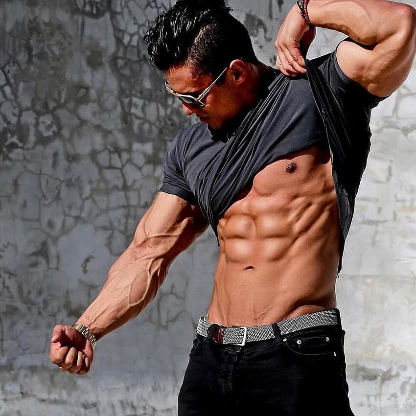 Stephen Pinto flexing his vascular and ripped muscles