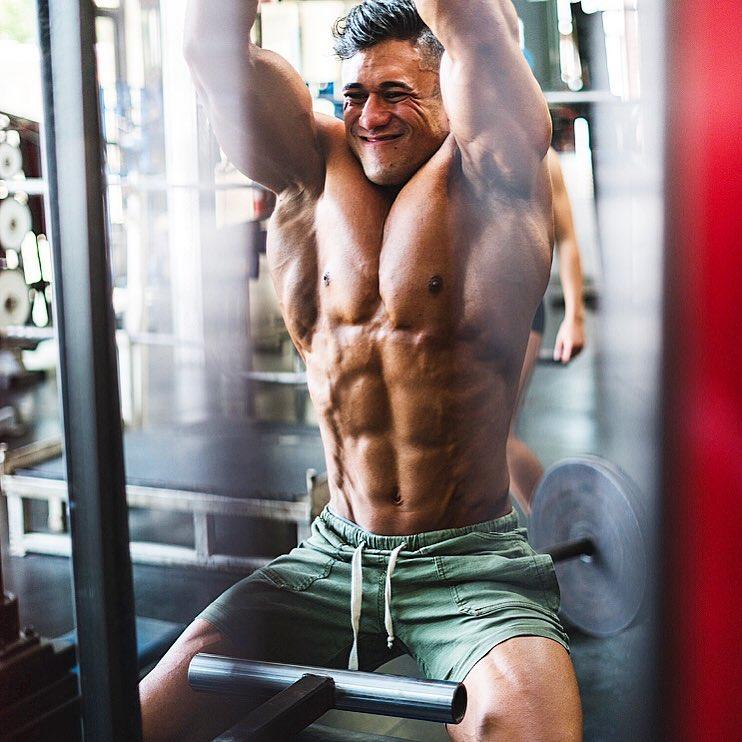 Stephen Pinto doing lat pulldowns shirtless