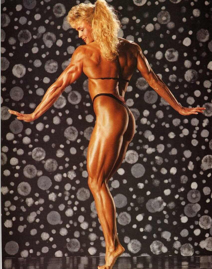 Tonya Knight showcasing her back, legs and glutes in a professional bodybuilding photo shoot