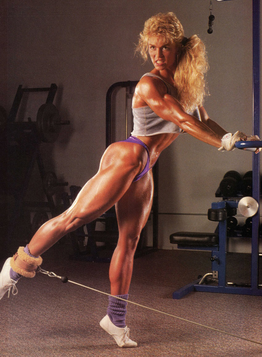 Tonya Knight doing glute kickbacks in the gym, looking curvy and lean