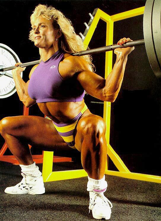 Tonya Knight doing squats in the gym