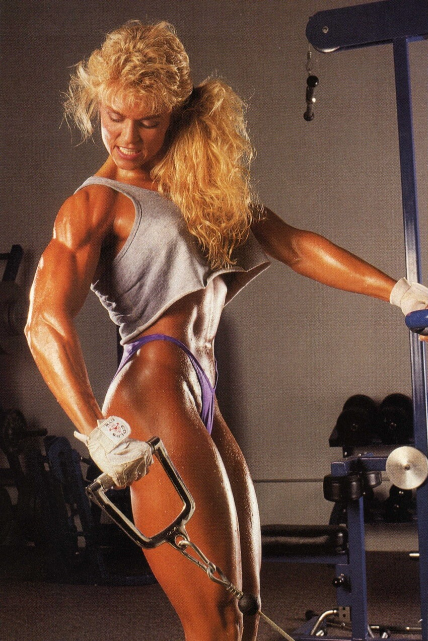 Tonya Knight doing cable lateral raises looking ripped and muscular
