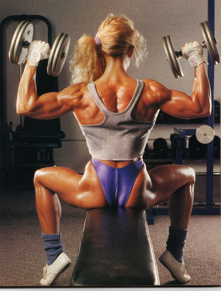 Tonya Knight doing seated shoulder press looking phenomenal