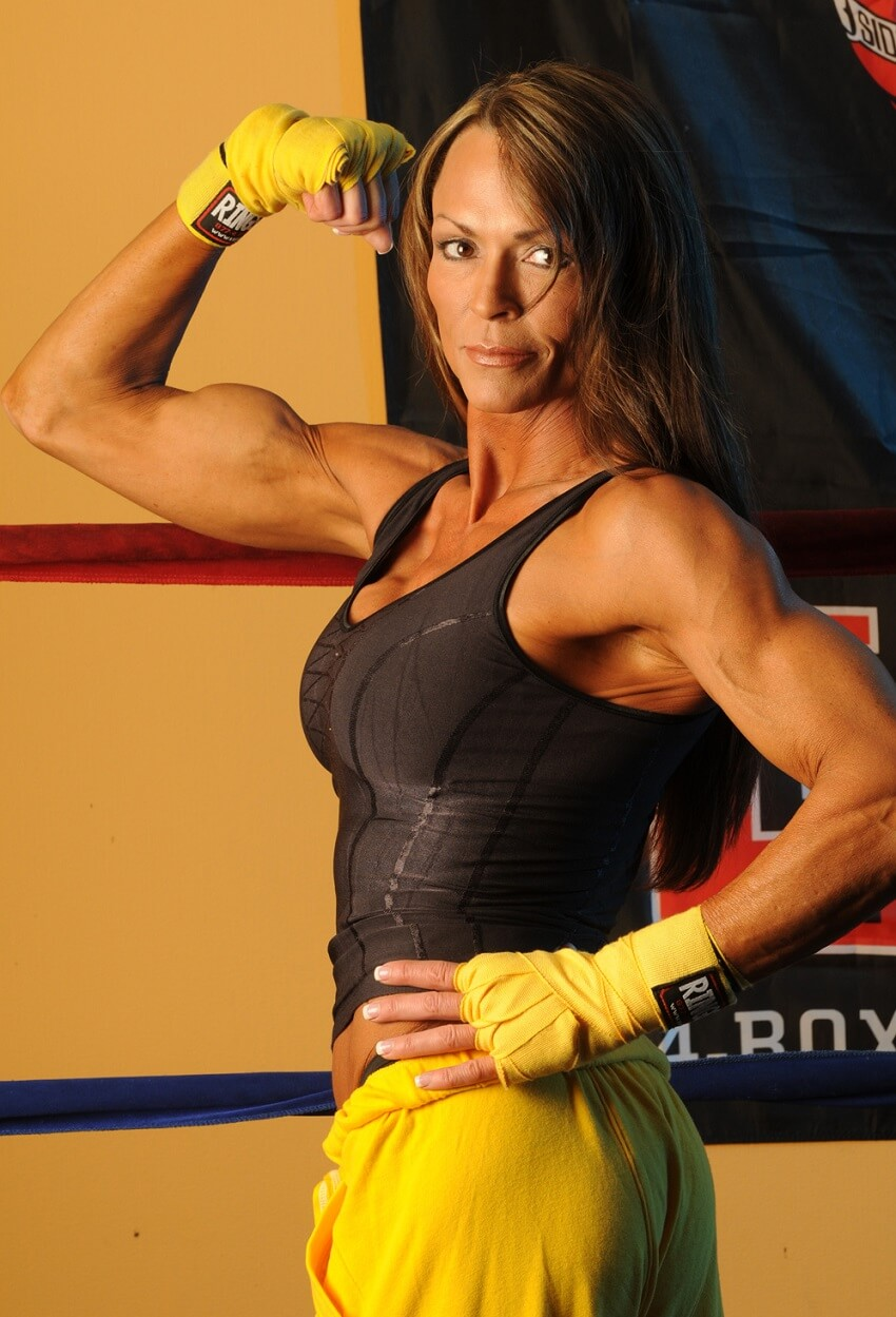 Tonya Knight in a 2010 fitness photo shoot, flexing her biceps