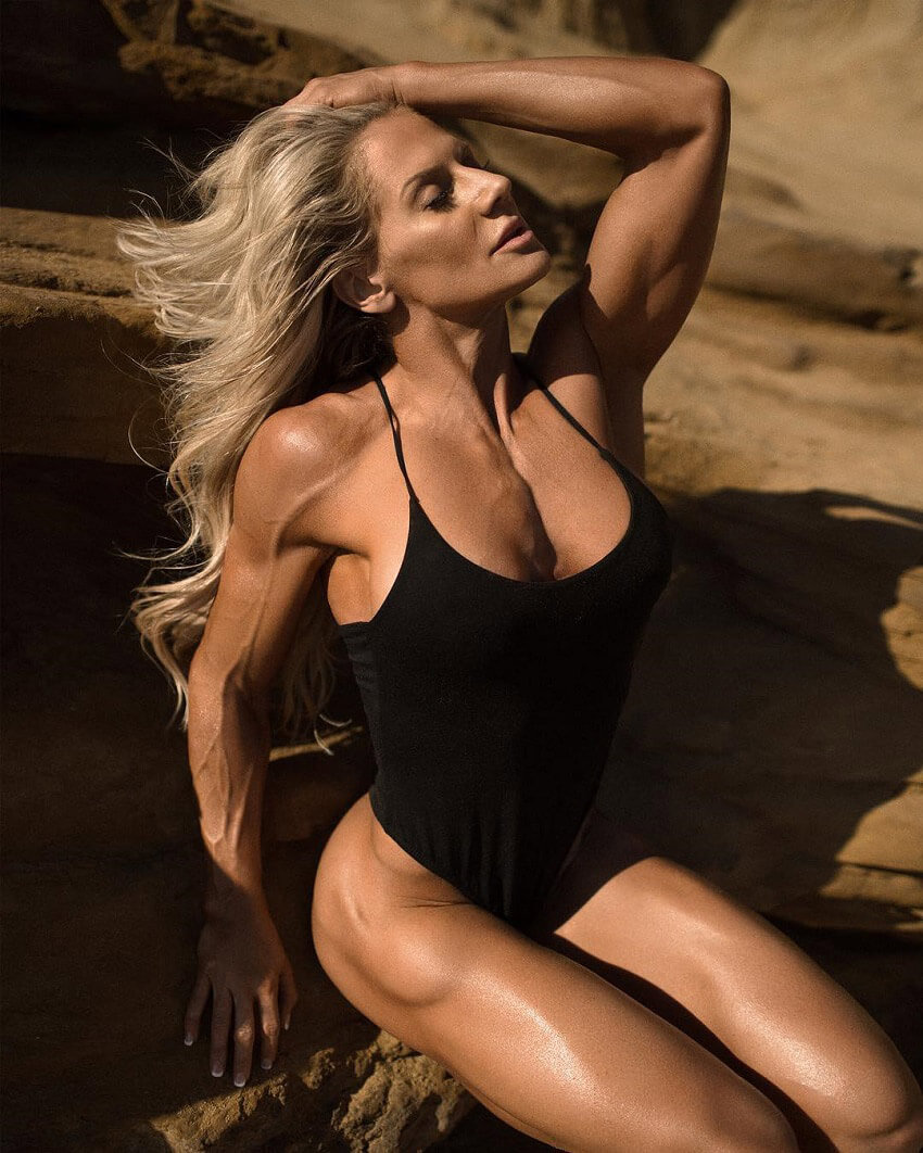 Whitney Jones sitting on a rock outdoors looking fit and lean