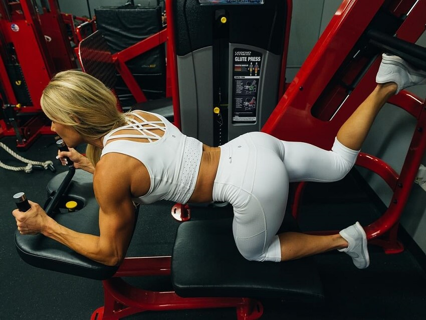 Whitney Jones performing a glute exercise in the gym
