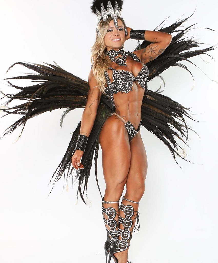 Carol Franca posing for a photo shoot in a WBFF fitness outfit