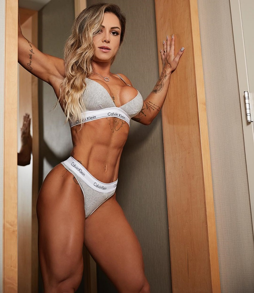 Carol Franca posing for a photo looking lean and fit in her sportsbra