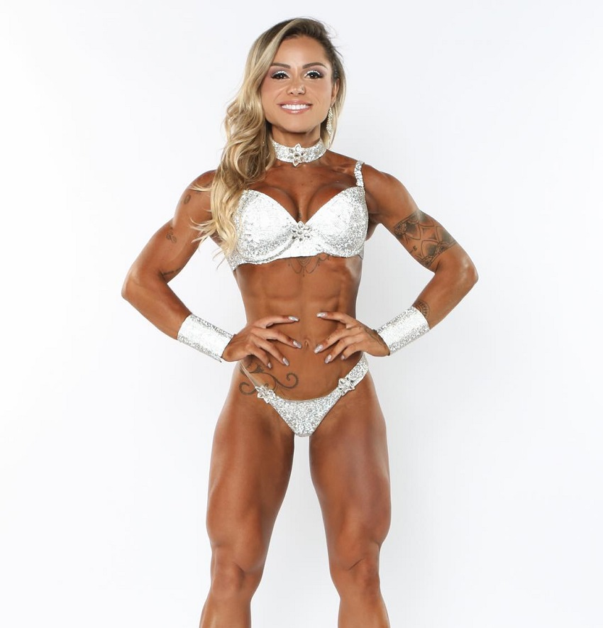 Carol Franca posing in a professional WBFF fitness photo shoot