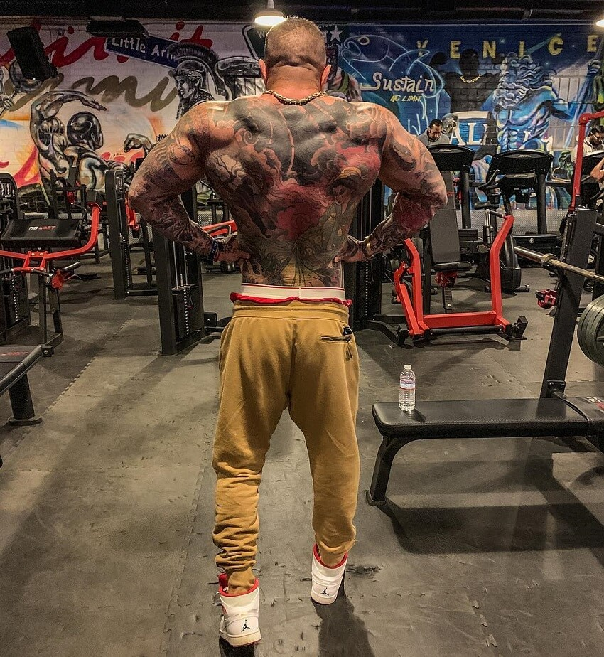 Jack Torosian performing a rear lat spread in the gym