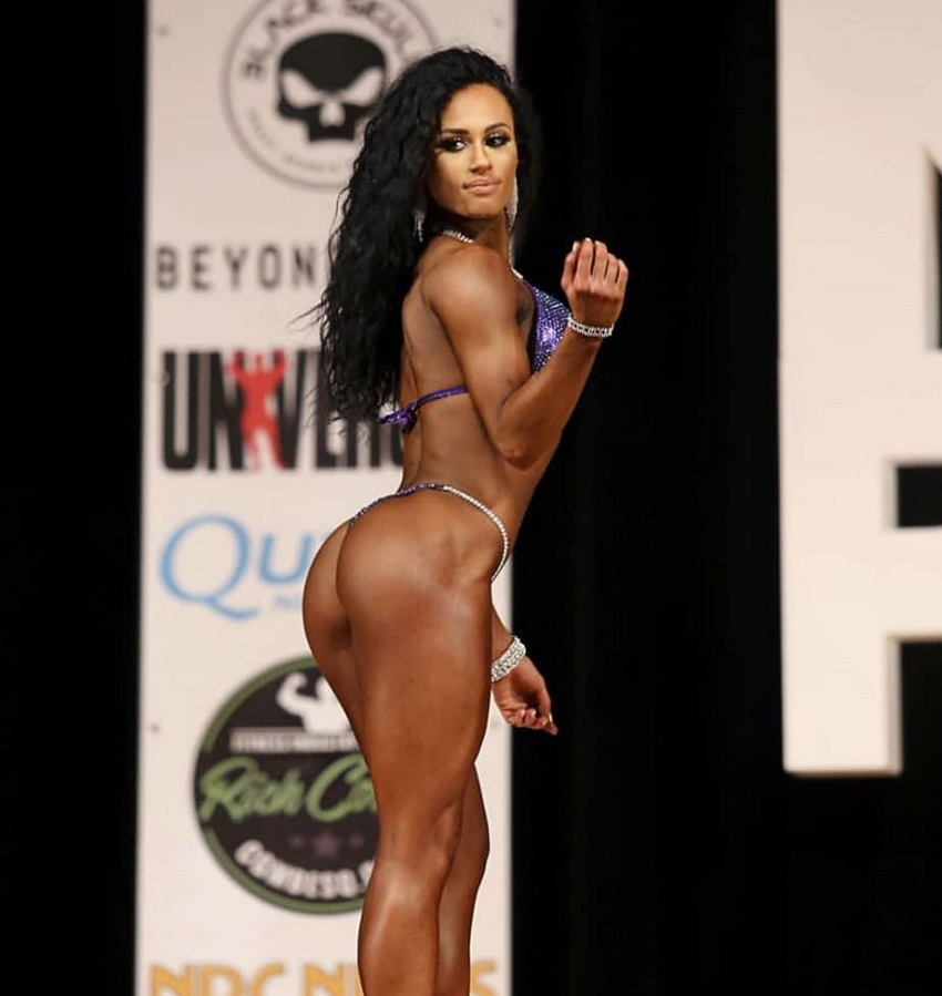 Jennifer Dorie showcasing her legs and glutes on the bodybuilding stage