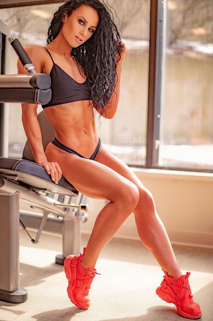 Jennifer Dorie sitting in a gym looking fit and lean