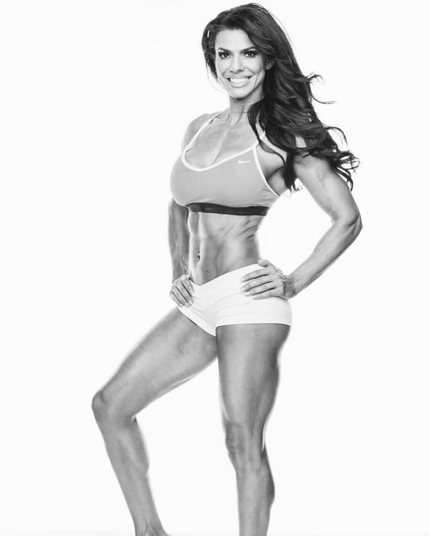 Mona Muresan posing in a black and white photo looking lean