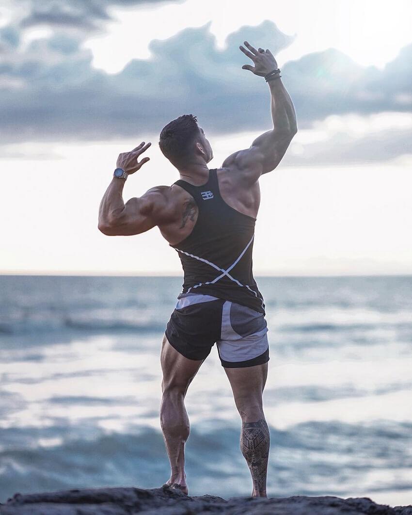 Nicolas Iong flexing at the sea