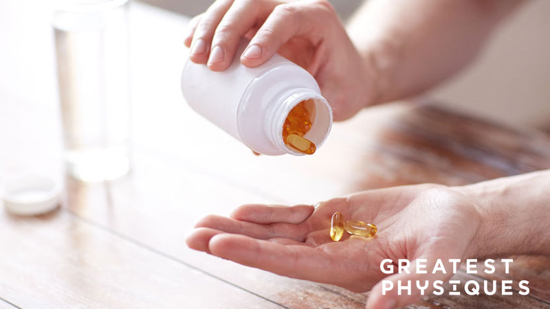 Man tipping multivitamins into his hand