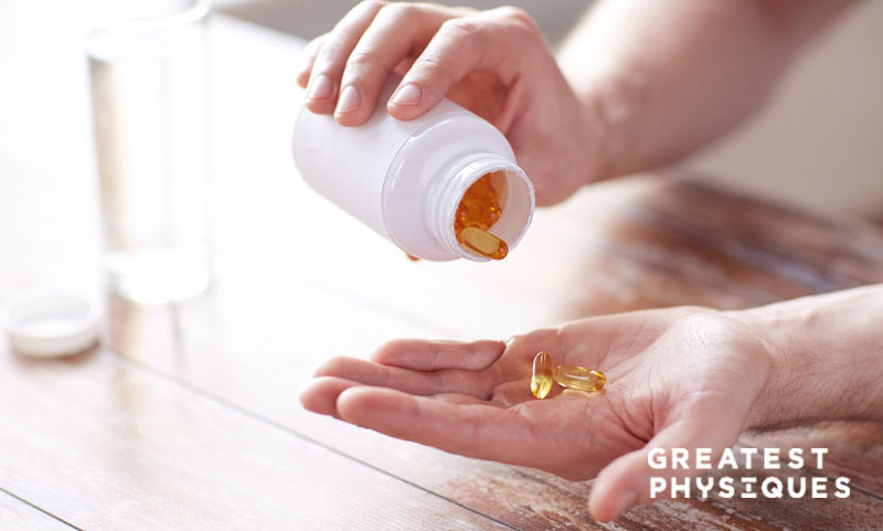 Man tipping omega-3 capsules into his hand