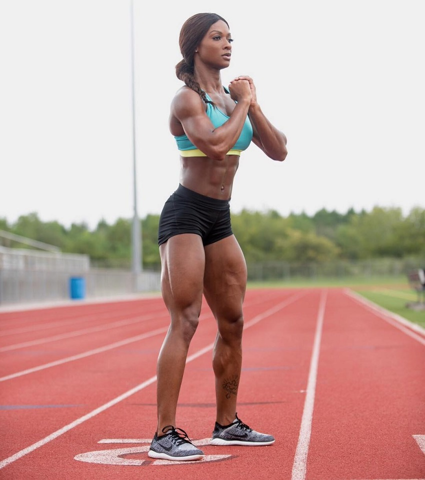 Candice Carter doing bodyweight exercises on a track field looking curvy and strong