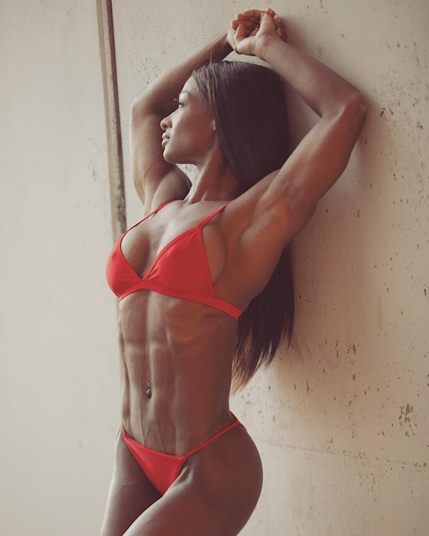 Candice Carter looking ripped and aesthetic in her red bikini