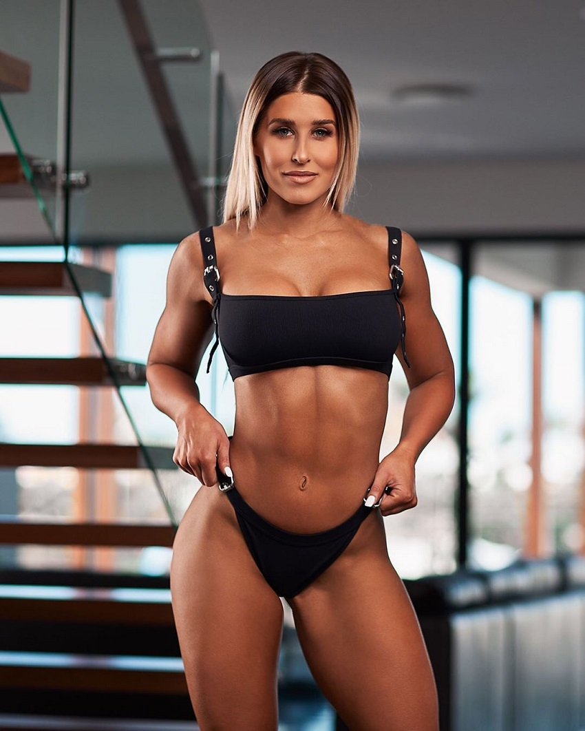 Julia Woodford posing in a modeling photo shoot, looking fit and lean