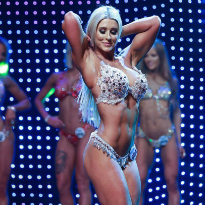 Julia Woodford posing on the fitness stage