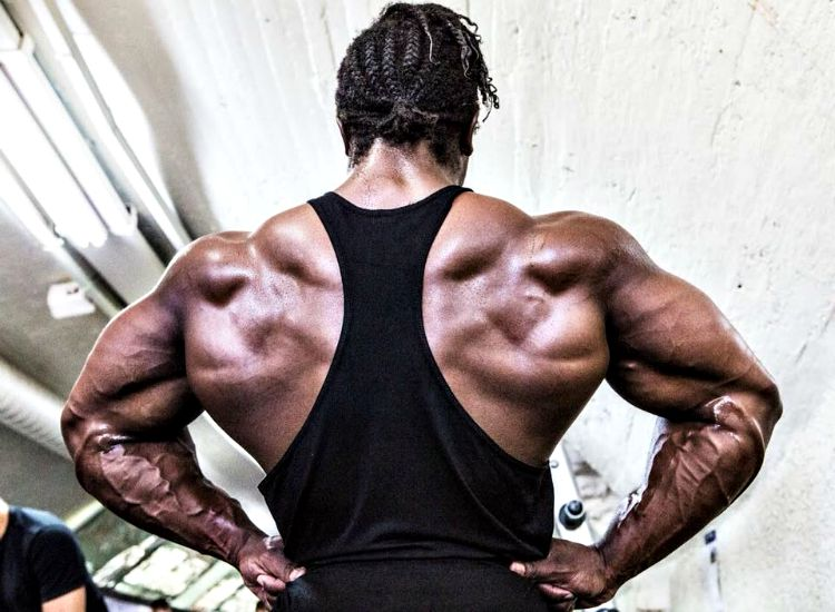 Kwame Duah spreading his ripped and huge lats
