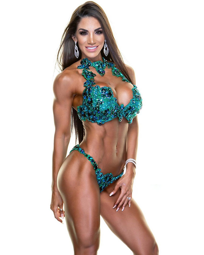 Libby Powell posing in a professional fitness WBFF photo shoot, looking ripped and aesthetic