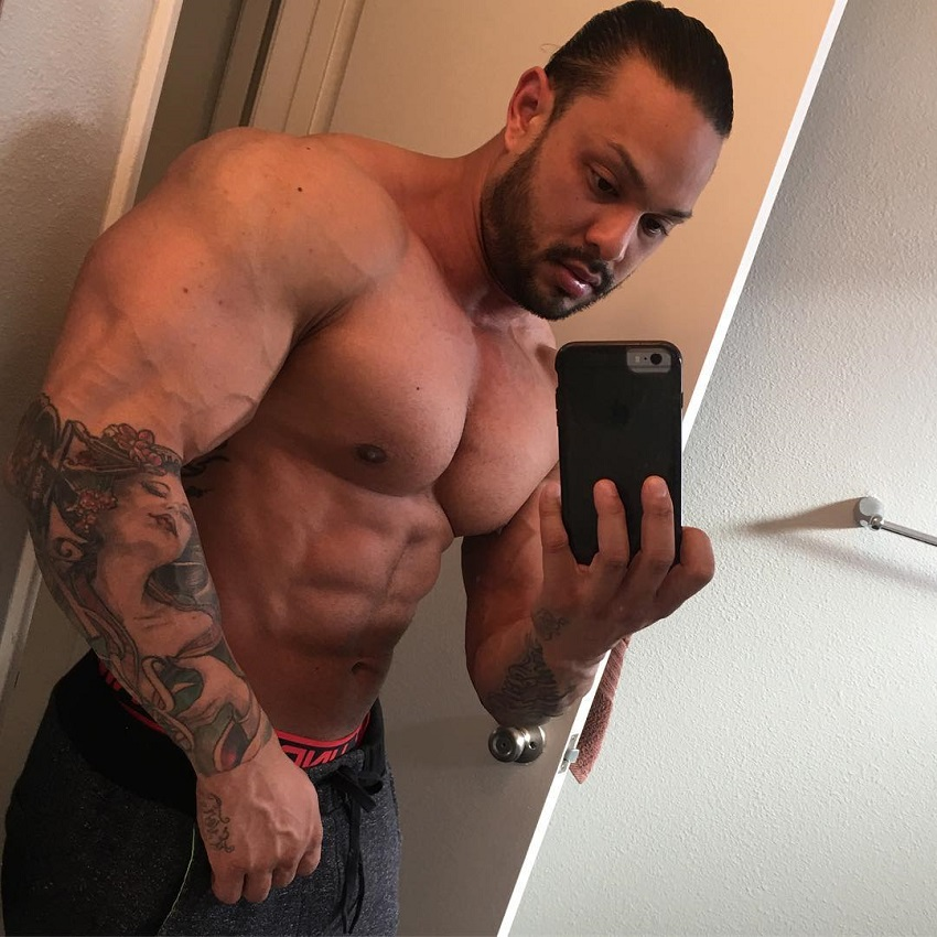 Mark Anthony taking a selfie of his ripped and swole physique