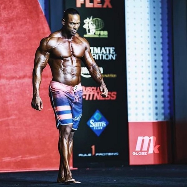 Mark Anthony walking down the Mr. Men's Physique Olympia stage