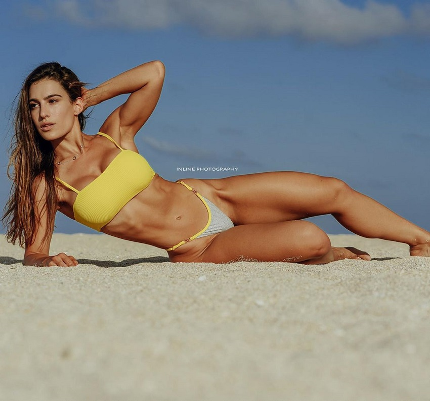 Andrea Thomas posing on the beach looking fit and lean
