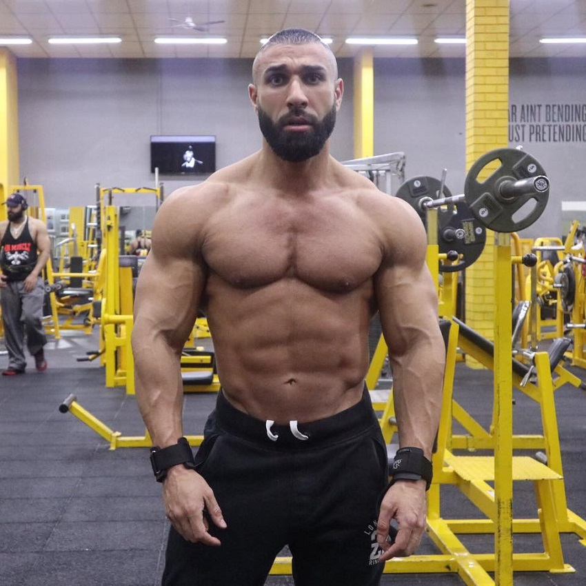 Basem Altakrity posing shirtless in the gym looking ripped
