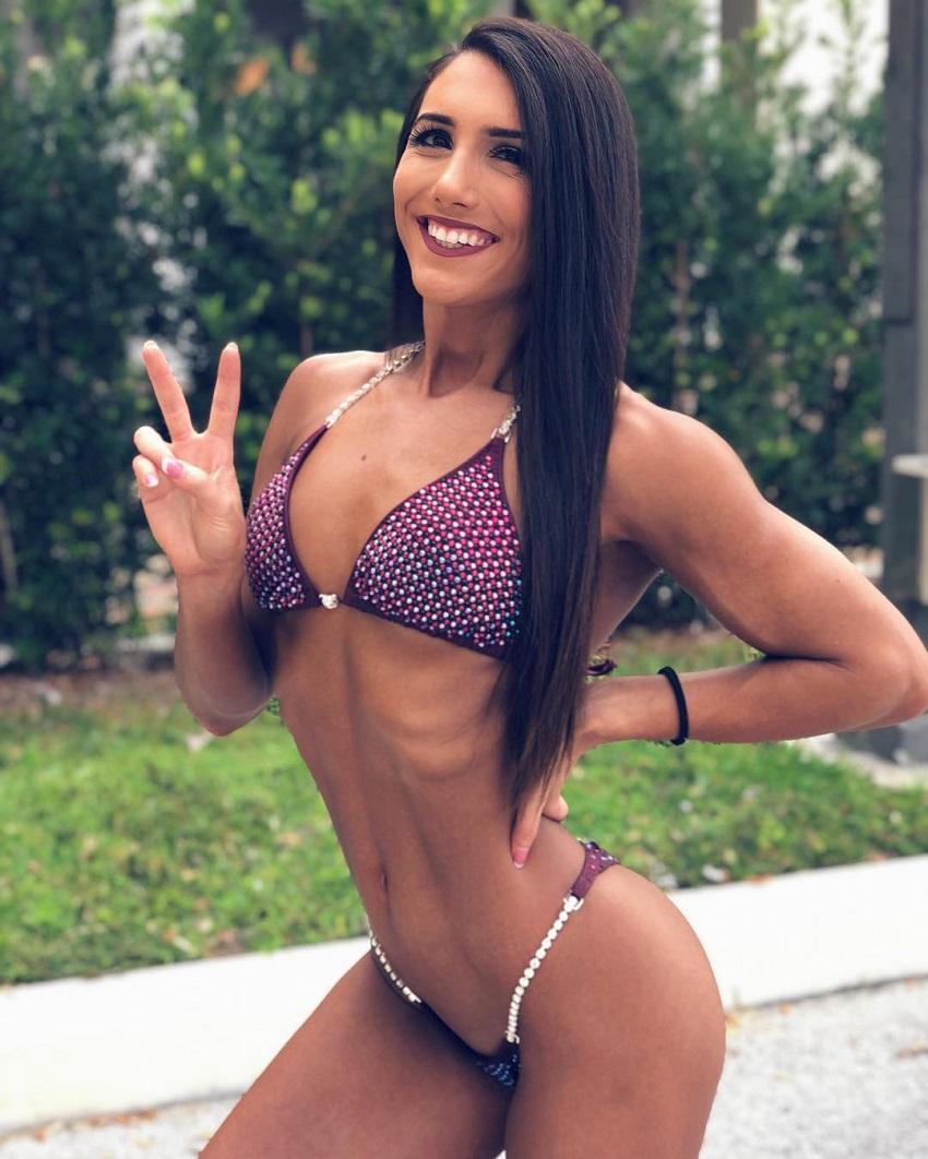 Jen Butters posing in a fitness bikini outfit