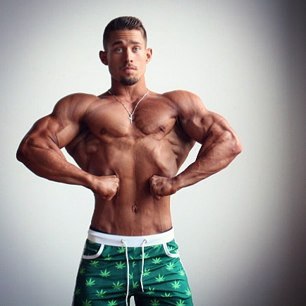 Jordan Strickland posing front lat spread shirtless